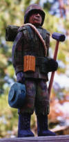 "COMBAT ENGINEER:  This carving was made for a friend in Kansas City.  He is 11"" tall and carved in basswood. (1996)"