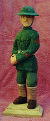 "WWI MARINE:  This carving is 11"" tall and carved in bass wood.  It was made for a friend who got commissioned a 2dLt.  This carving lives in Yuma, AZ.  (1998)"